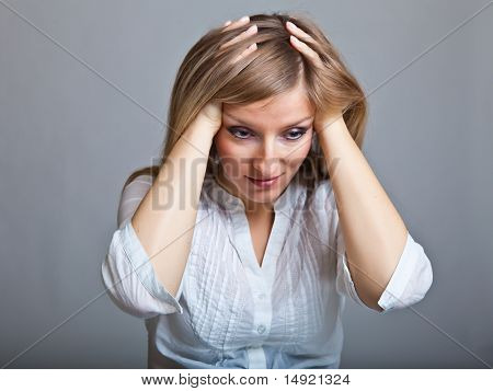 Depressed sad woman on neutral background