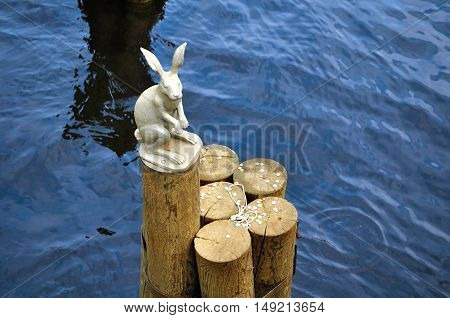 SAINT-PETERSBURG RUSSIA - MAY 27 2015. Monument to hare on the top of wooden pole next to Ioannovsky Bridge near Peter and Paul fortress in St Petersburg Russia