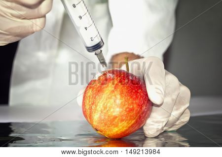 Red apple in genetic engineering laboratory gmo food concept.