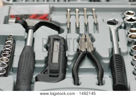 Toolkit With Various Carpenter Tools In The Box