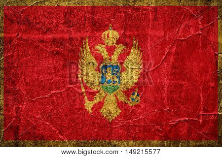 Flag of Montenegro overlaid with grunge texture