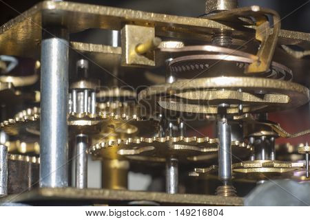 the closeup shot of old clock mechanism