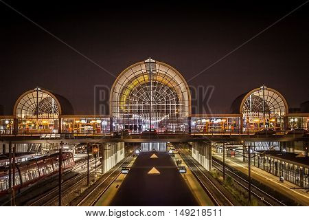 view over a train station at night time