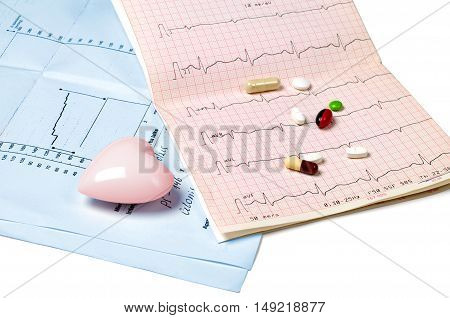 Electrocardiogram tablets and heart on white background