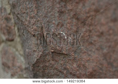 relief of an old granite wall, old granite wall