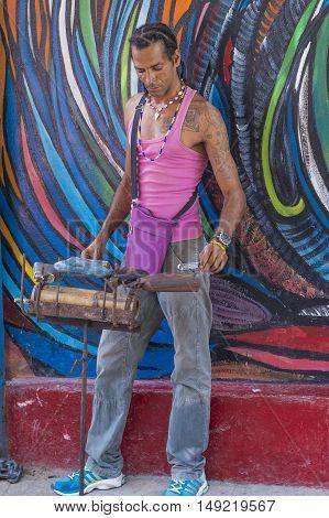 HAVANA CUBA - JULY 18 : Cuban Rumba drummer in Havana Cuba on July 18 2016. Rumba is a secular genre of Cuban music involving dance percussion and song. It originated in the northern regions of Cuba