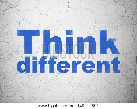 Studying concept: Blue Think Different on textured concrete wall background