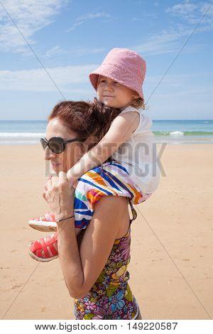 Mother Shouldering Baby
