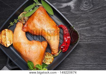 Smoked chicken legs with grilled vegetables top view with copy space