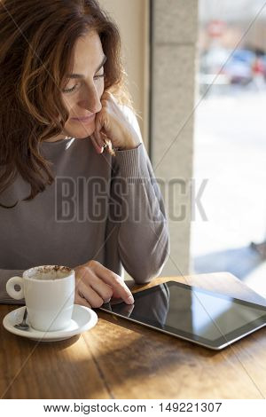Woman Tablet In Cafe Vertical