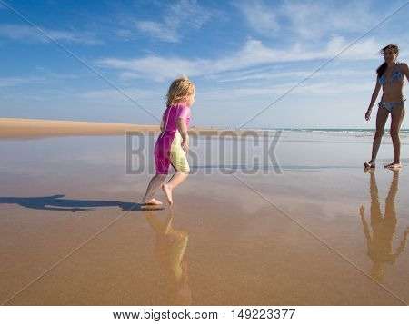 Baby Running At Shore To Mother