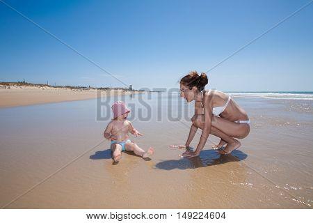 Woman And Baby At Seashore