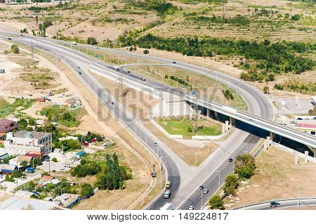 Road flyover in summer day. construction and green trees