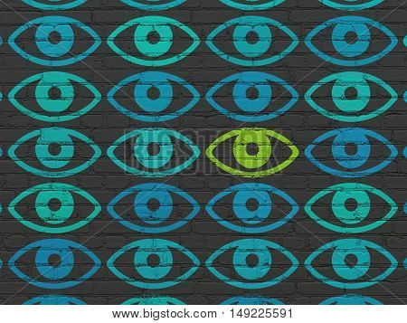 Privacy concept: rows of Painted blue eye icons around green eye icon on Black Brick wall background