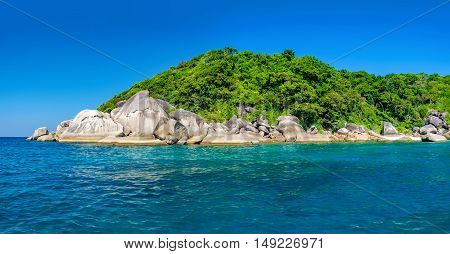 Water excursion to the Similan Island Andaman Sea Thailand. Beautiful landscape with the rock white sand beach and dense tropical forest.