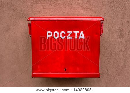 Red mailbox hanging on the wall in Warsaw Poland