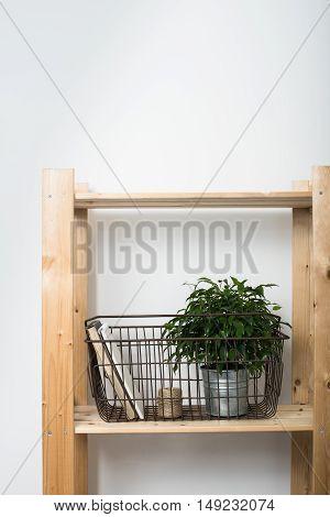 Simple minimalist furniture, wooden shelf with home interior decor.
