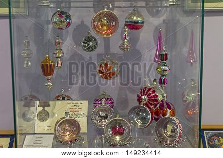 KLIN RUSSIA - JANUARY 16 2016: Christmas balls with pictures inside. Museum of Christmas toys.