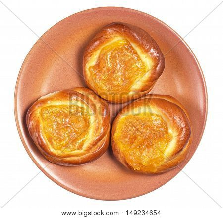 Buns with apricot jam in plate isolated on white background top view