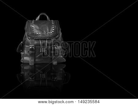 luxury leather black hand bag with diamond studs and dual small side bag for women on black background and reflection shadow isolated included clipping path