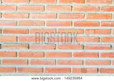 orange color bricks wall building background pattern