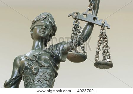 Themis in the Lawyer Office and coins are in the scales, shallow depth of field