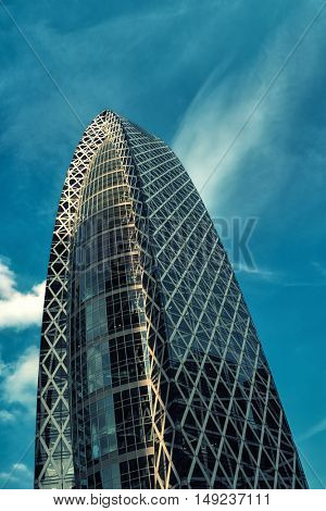 Tokyo - May 2016: Mode Gakuen Cocoon Tower, bottom view against blue sky. Shinjuku