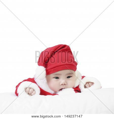 cheerful child wearing santa claus suit and something stare in studio for christmas or happy new year on white background