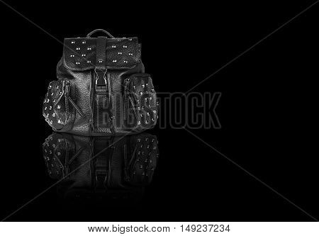 chic luxury leather black bag with clip lock diamond studs and dual small bag zipper for women on black background and reflection shadow isolated included clipping path