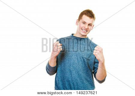 Success positive emotions. Happy young man successful lad with arms up clenching fist isolated on white background