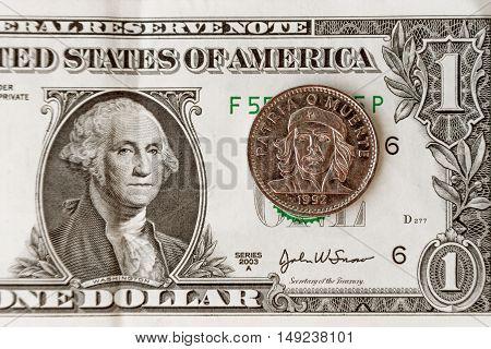 Dollar Bill With A Coin Three Cuban Pesos