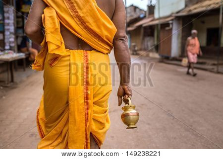 Gokarna, India - January 19, 2016: Unidentified temple brahmin walk on the streets of Gokarna. The city is a holy pilgrimage site for Hinduists