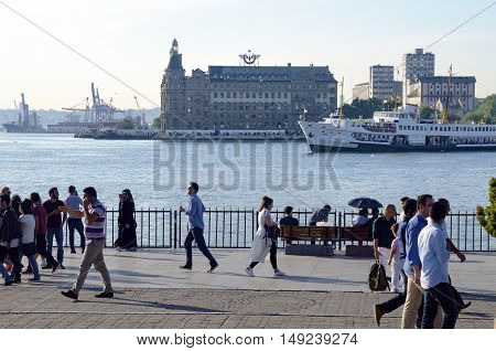 Istanbul, Turkey - May 29, 2016: The centre of Kadikoy today is the transportation hub for people commuting between the Asian side of the city and the European side across the Bosphorus. There is a large bus and minibus terminal next to the ferry docks.