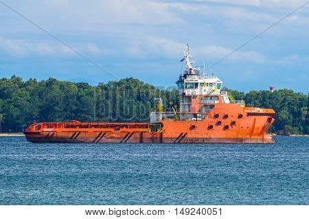 Labuan,Malaysia-Sept 26,2016:View of a typical supply boat or vesse at Labuan sea.Labuan strategically located in the hub of Asia-Pacific and the ASEAN offshore oil exploration and production region.