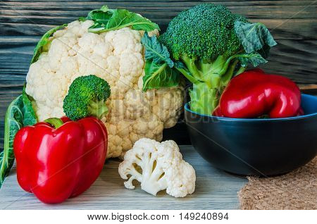 broccoli pepper and other vegetables closeup on wooden background