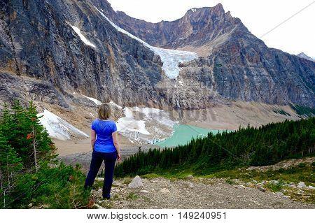 Woman relaxing on mountain top. Candian Rockies. Alberta. Canada.