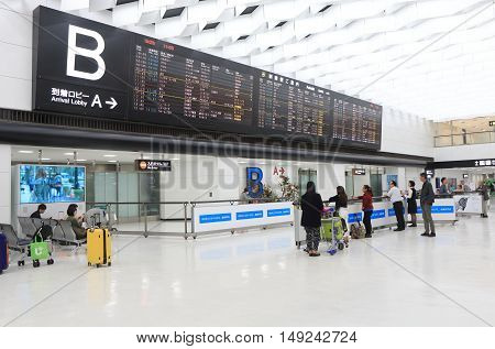 TOKYO JAPAN - SEPTEMBER 23, 2016: Unidentified people check flight schedule at Narita airport in Tokyo.