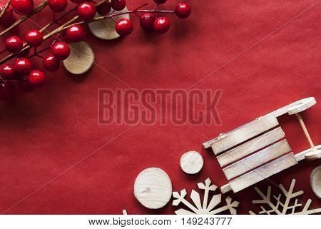Christmas Decoration Like Wooden Sleigh. Card For Seasons Greetings With Wrapping Paper Background. Copy Space For Advertisement