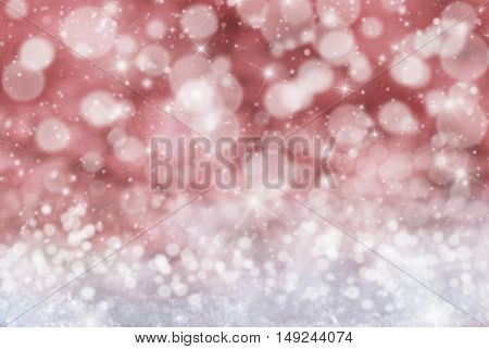 Christmas Texture With Sparkling Stars. Snow And Snowflakes With Red Background. Magic Bokeh Effect With Lights. Copy Space For Advertisement. Card For Seasons Greetings