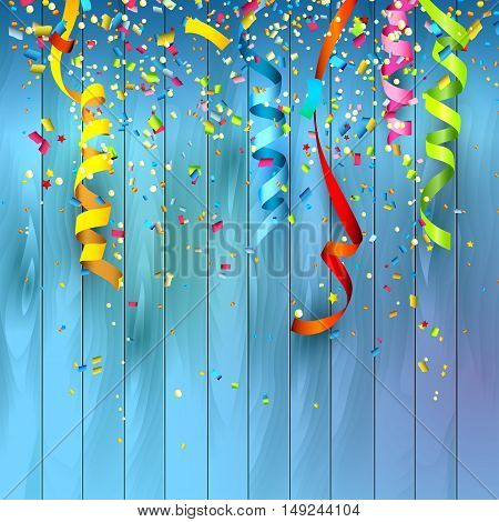 Colorful confetti and streamers on wooden background