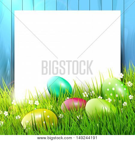 Easter background with colorful eggs in grass and clear paper