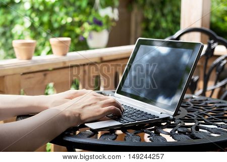 Working On Terrace With Laptop / Business Tablet With Keyboard On A Metal Table