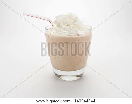 MIlk Shake with Straw and Whipped Cream on White Background