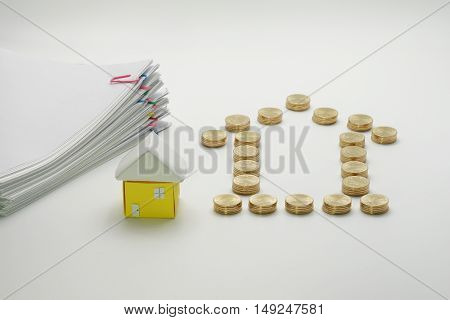 Pile of gold coins and house with pile overload document with colorful paperclip on white background.