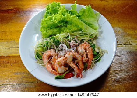 sunflower sprout with shrimp and squid spicy salad on dish
