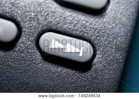 Macro Of A Black Skip Forward Button On Black Remote Control For A Hifi Stereo Audio System