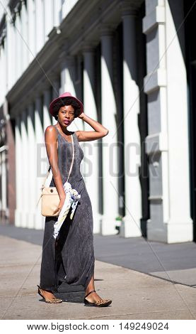 Portrait of young African American girl walking on city street. Photographed in Soho NYC.