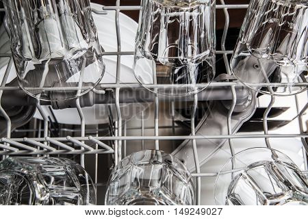 Clean Transparent Glasses Into Modern Dishwasher Machine