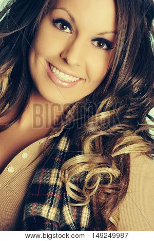 Pretty smiling young woman wearing scarf