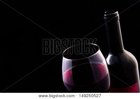 Red Vine In Glass And Open Bottle